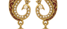 Gold Plated Jhumkis Embellished With Pearl Beads; Green Stones